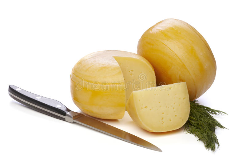 Cheese wheels. With dill and knife on white background stock photos