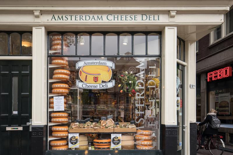 Cheese wheels in Amsterdam store. Netherlands. Amsterdam, Netherlands - April 20, 2017: Cheese wheels in Amsterdam store. Netherlands stock photo