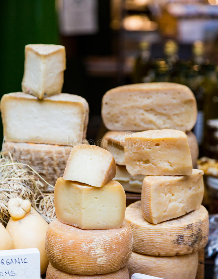 Cheese Wheels in Market. Cheese Wheels in Farmers Market stock images