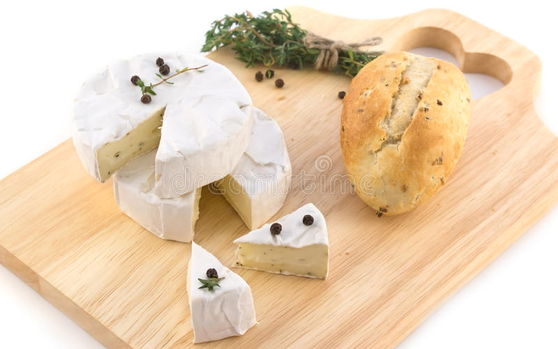 Cheese With White Mold And Herbs Stock Images