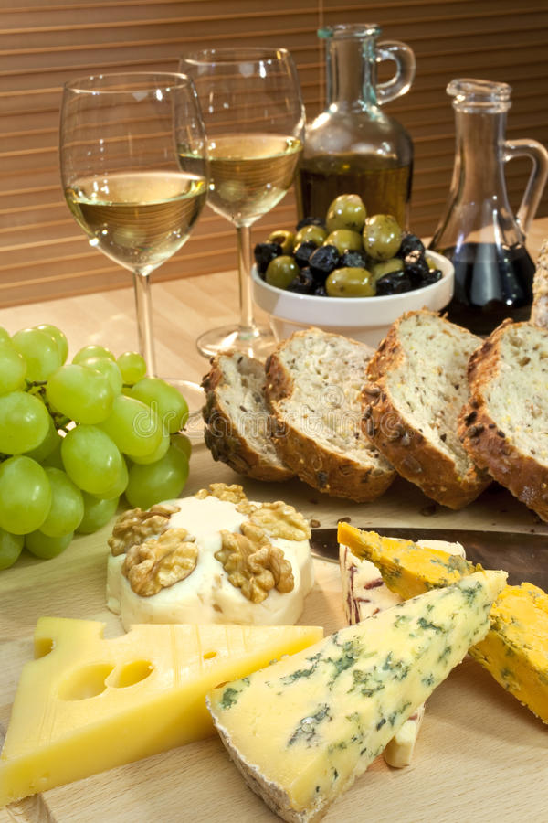 Cheese, White Wine, Grapes, Olives, Bread stock photography