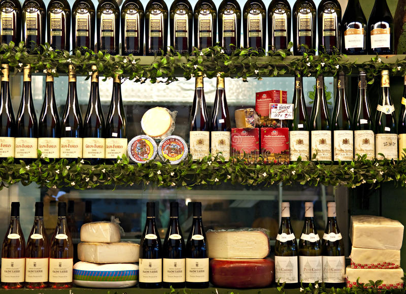 Cheese and wine. Large cheese and wine selection on shelf stock images