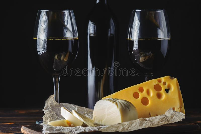 Cheese wine in glasses on a black background royalty free stock images