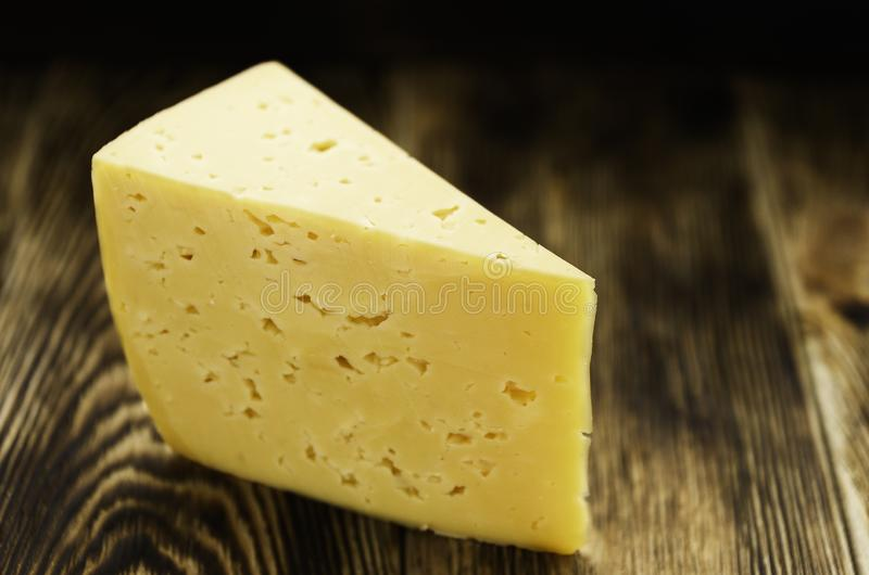 Cheese on a wooden surface stock image