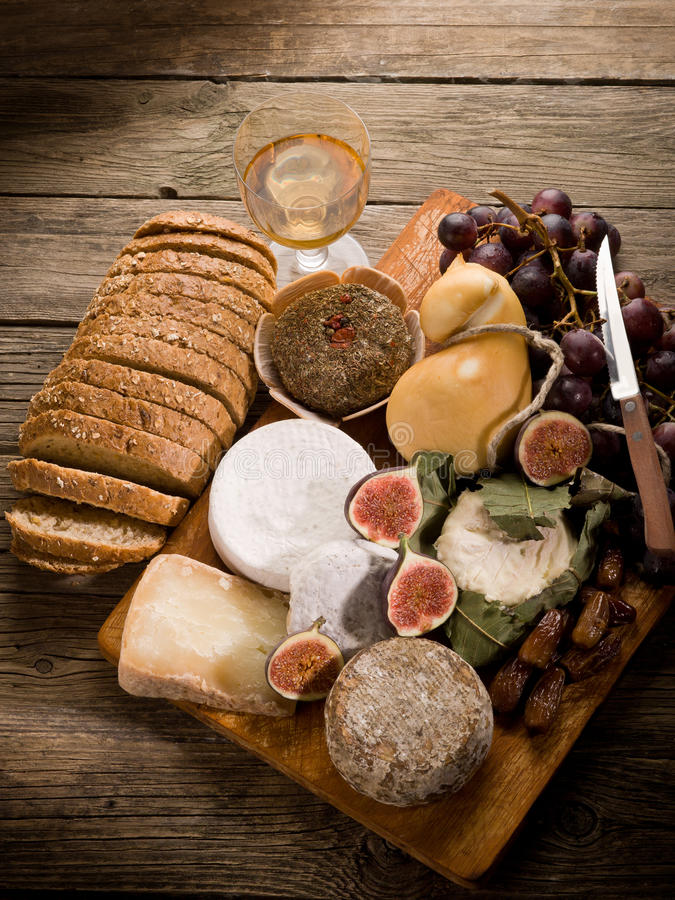 Cheeseboard  With Cheese And Fruit Stock Image