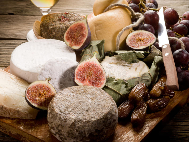 Download Cheeseboard  With Cheese And Fruit Royalty Free Stock Photos - Image: 21407108
