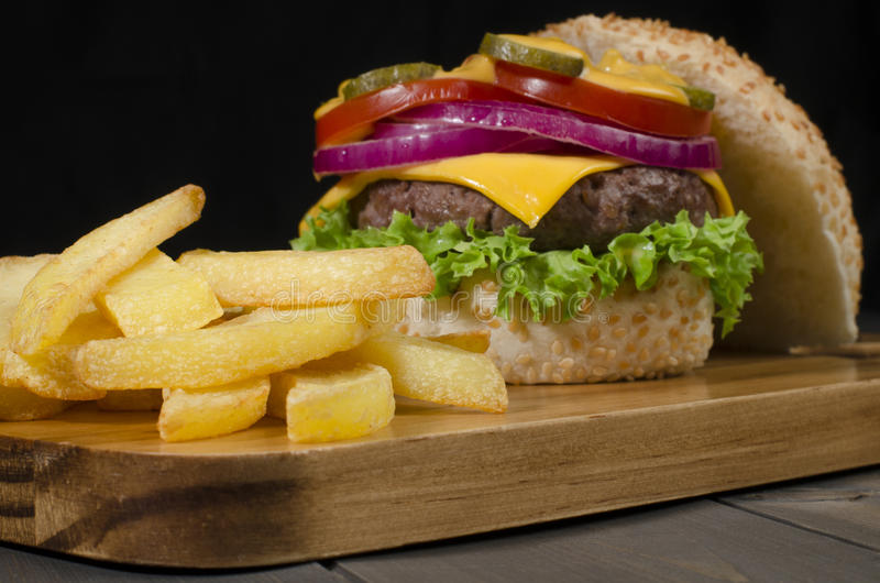 Download Cheeseburger and Chips stock photo. Image of black, background - 28296804