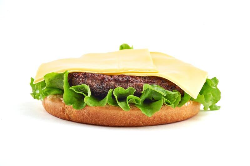 Cheeseburger clásico imagen de archivo