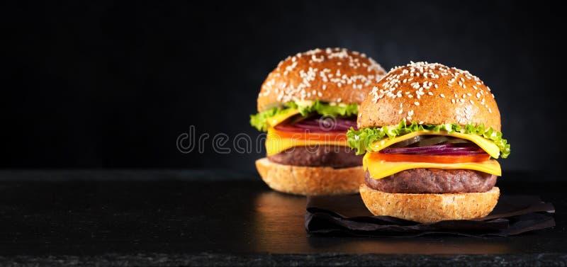 Cheeseburger degli hamburger degli hamburger fotografia stock