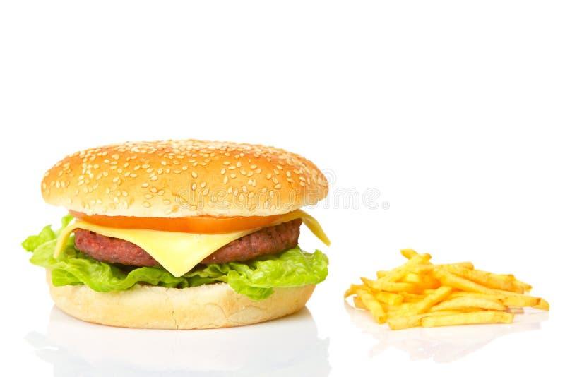 Cheeseburger et pommes frites images stock