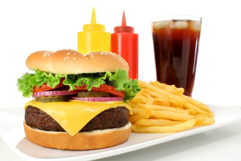 cheeseburger fast - hamburgera posiłek zdjęcia royalty free
