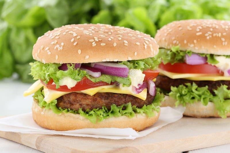 Cheeseburger hamburger burger tomatoes cheese royalty free stock image