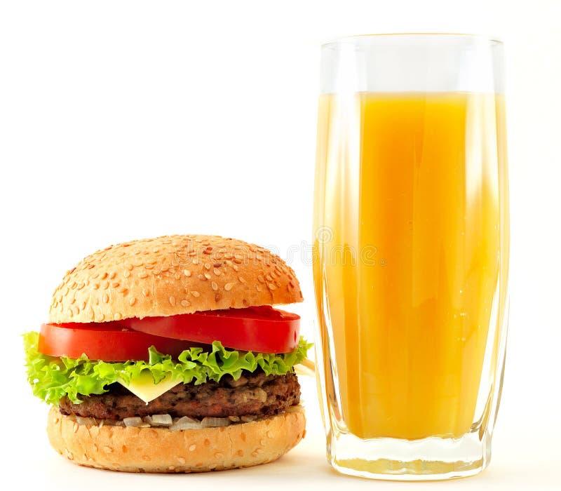 cheeseburger soku pomarańcze fotografia stock
