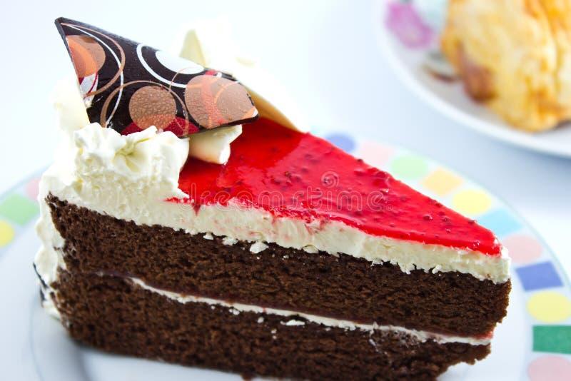 cheesecake φράουλα φετών chocola στοκ φωτογραφία
