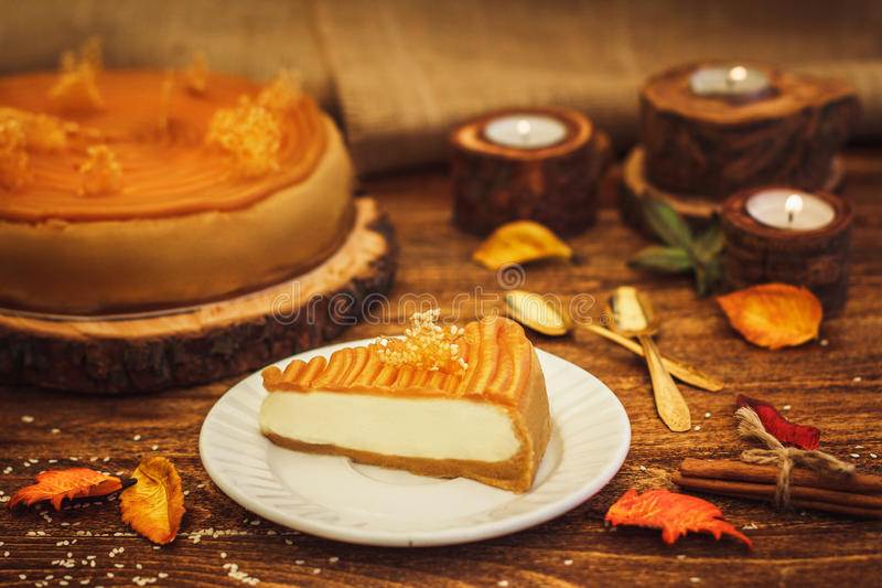 Cheesecake with caramel in rustic style royalty free stock photos