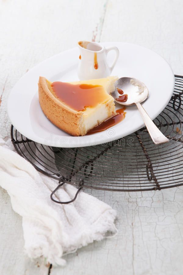 Cheesecake and caramel Sauce royalty free stock photography