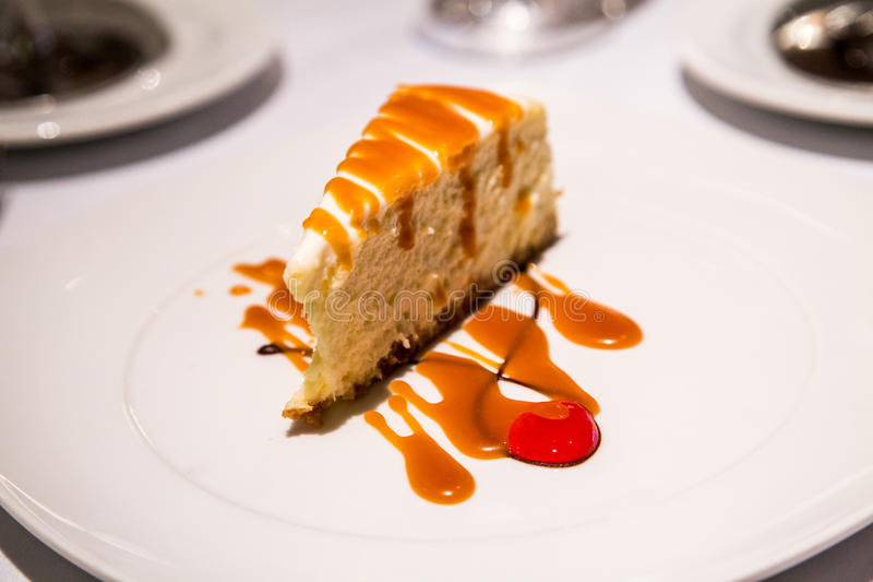 Cheesecake with Caramel Sauce. On White Plate stock images