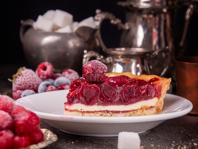 Cheesecake with cherry. Piece of cake on white plate.  royalty free stock images