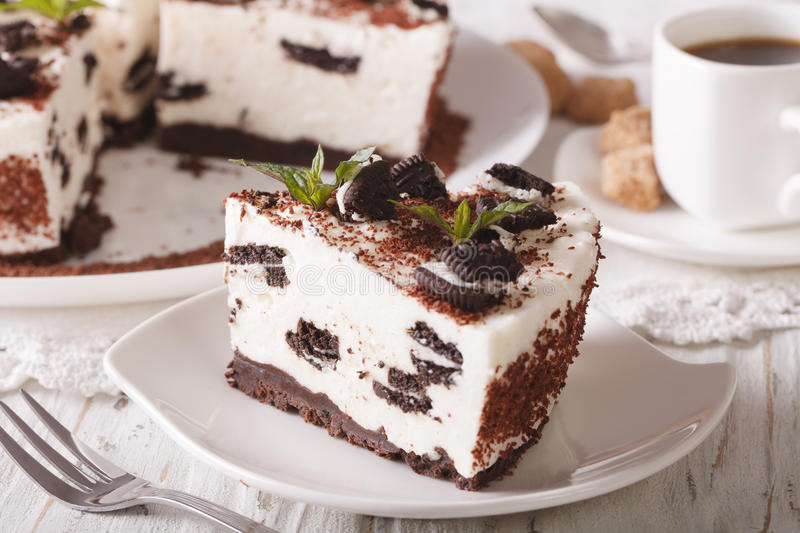 cheesecake with chocolate cookies close-up and coffee. horizontal stock photo