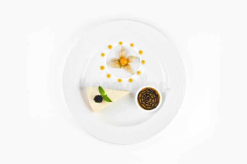 Cheesecake with chocolate cream, blackberries, mint and winter cherry stock image