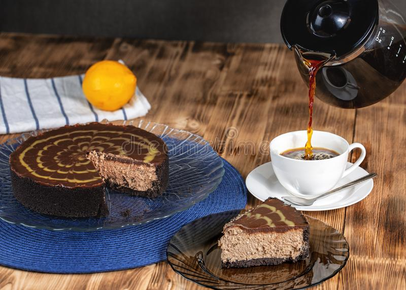 Cheesecake with coffee. On a wooden table stock images