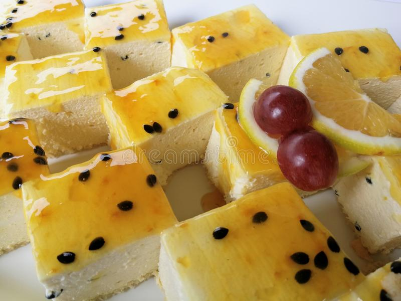 Cheesecake dessert topped with Granadilla stock images