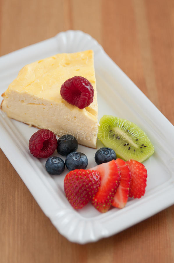 Cheesecake with fresh fruit. Vanilla Cheesecake with fresh fruit royalty free stock photos