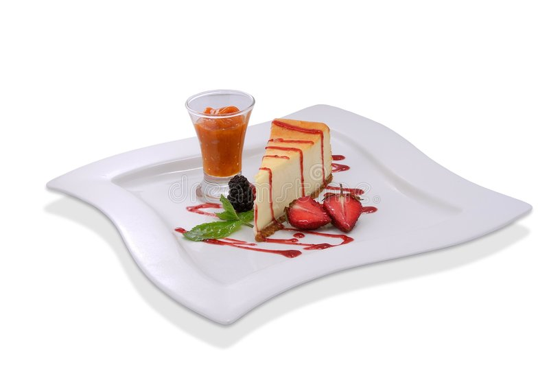 Cheesecake with fresh strawberries and blackberry stock image