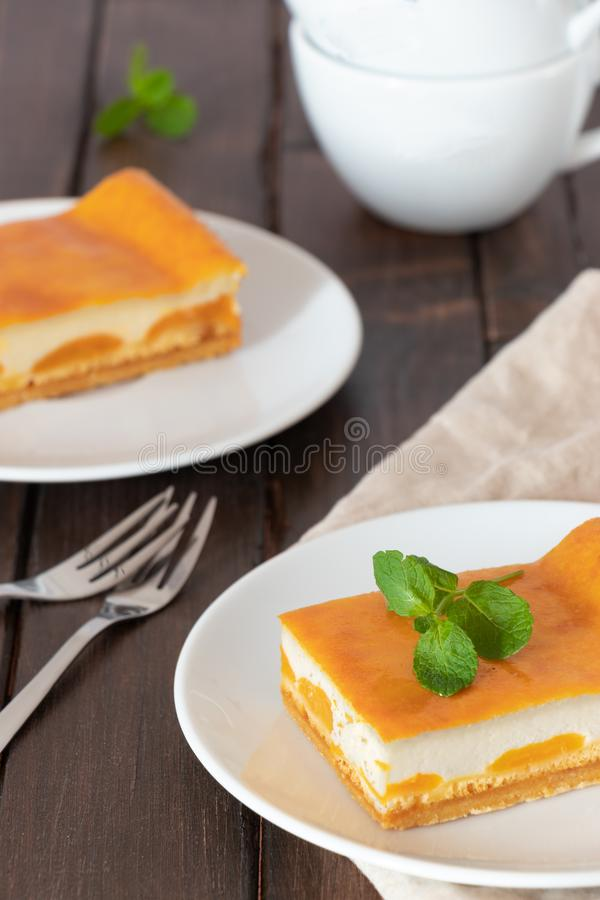 Cheesecake with fruit on a plate on a wodden table royalty free stock images