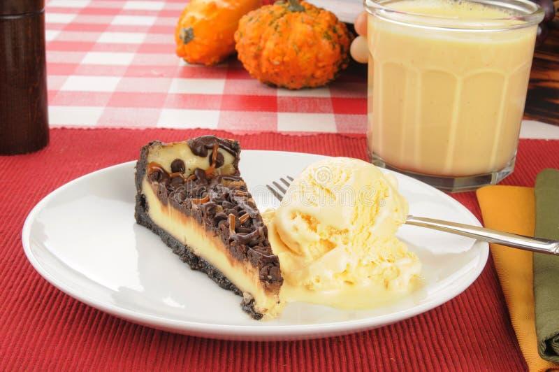 Cheesecake and ice crream. Turtle cheesecake with French vanilla ice cream and egg nog stock photo