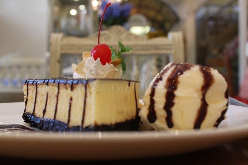 Cheesecake, icecream and banana. On white dish stock photos
