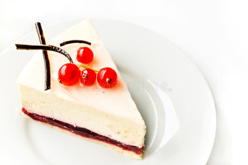 Cheesecake on white plate stock photography