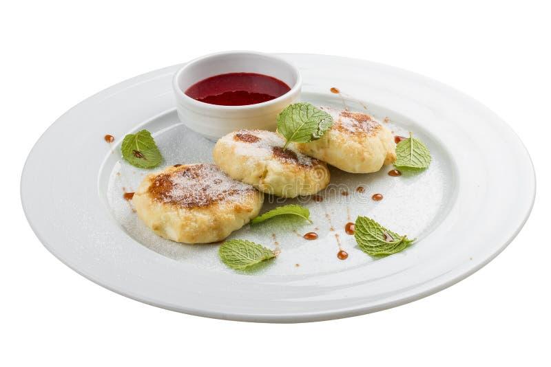cheesecakes Pancake della ricotta con panna acida immagine stock libera da diritti