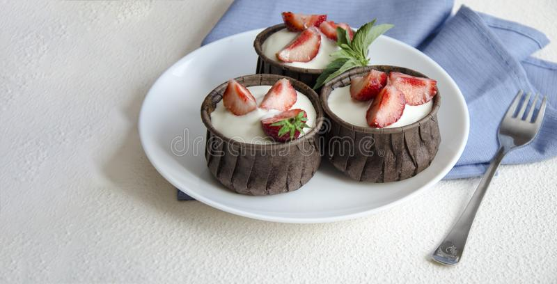Cheesecakes with strawberries. Menu for kids royalty free stock images