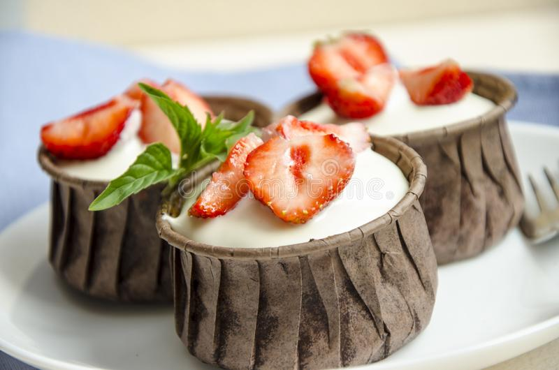 Cheesecakes with strawberries. Menu for kids stock photos