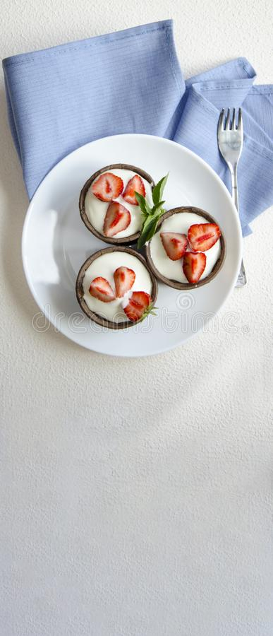 Cheesecakes with strawberries. Menu for kids royalty free stock photos