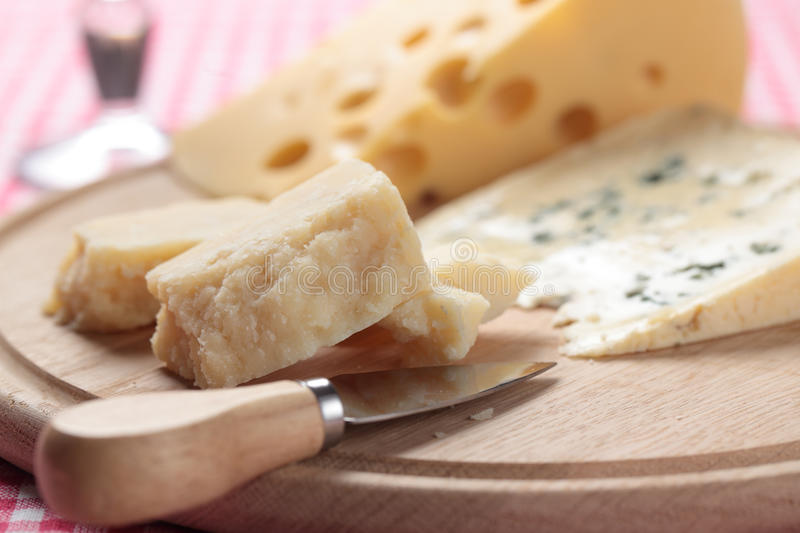 Cheeses on a cheese board stock photos