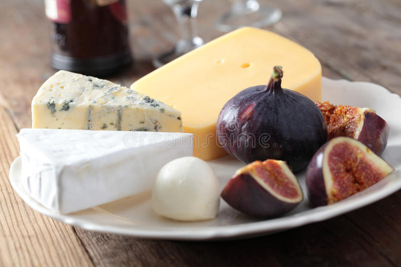Cheeses and figs stock photo
