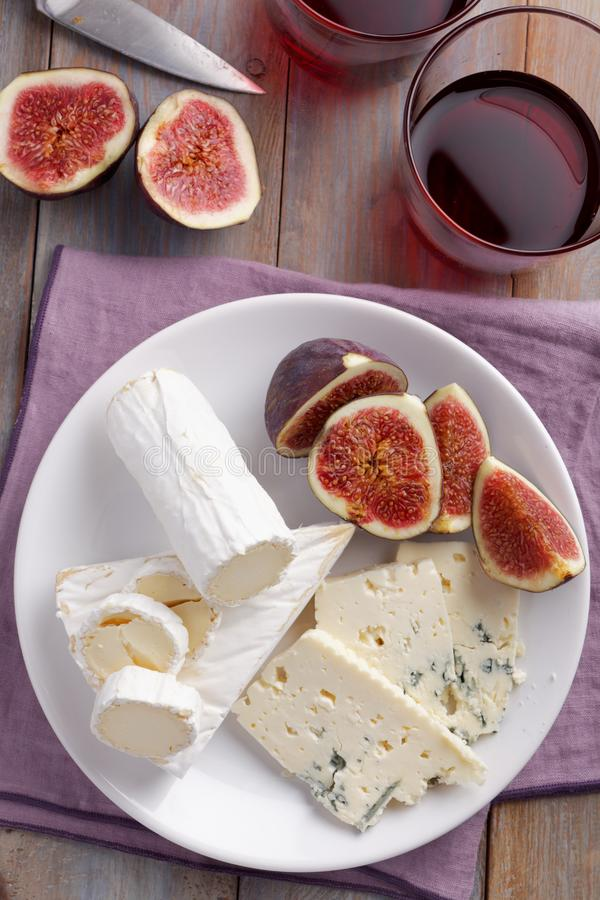 Cheeses and figs stock photos