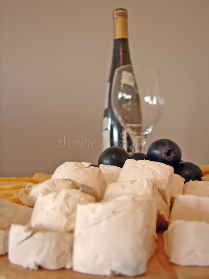 Cheeses plate and bottle of wine stock photos