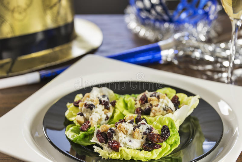 Cheesy lettuce boat appetizers are served at a New Years eve holiday party. stock photo