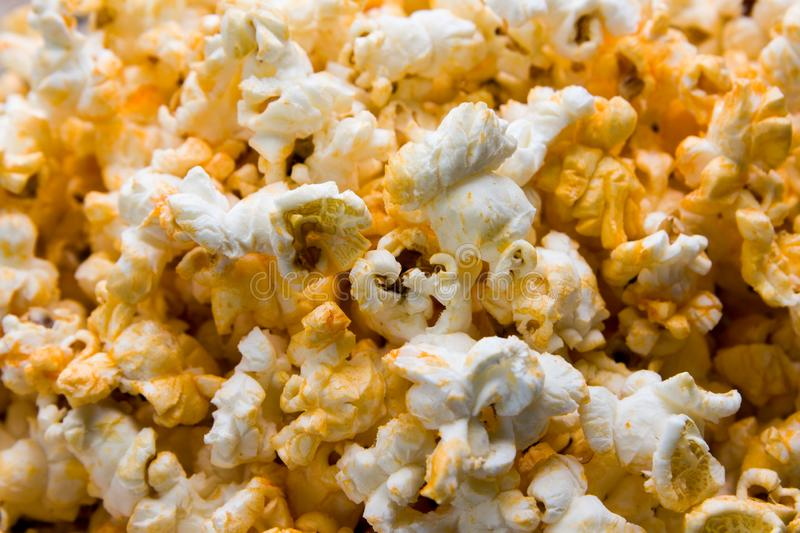 The cheesy popcorn top view background royalty free stock image