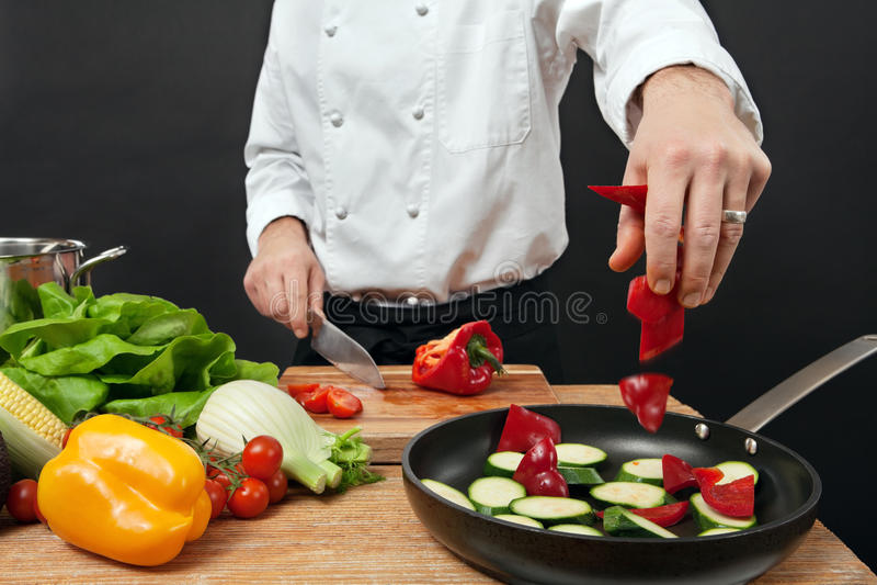 Chef adding ingredients stock photos