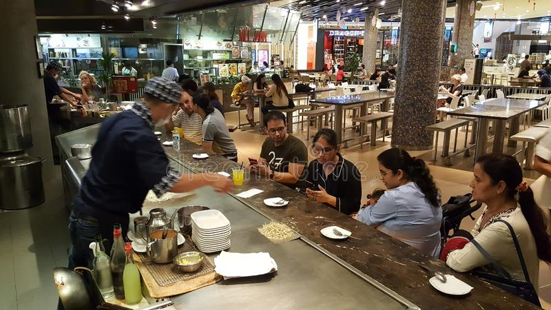 Live food service to guest in Kuala Lumpur in open kitchen stock photos