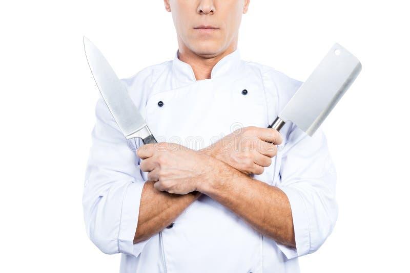 Chef avec des couteaux image libre de droits