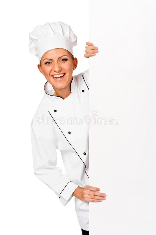 Chef, baker or cook smiling happy holding blank white paper sign. Isolated royalty free stock images
