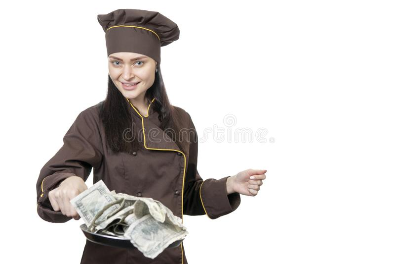 Chef bietet Dollar auf einer Bratpfanne an stockbild