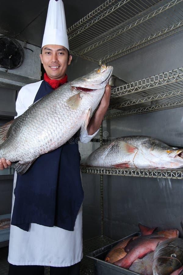 Chef And Big Fish Royalty Free Stock Photo
