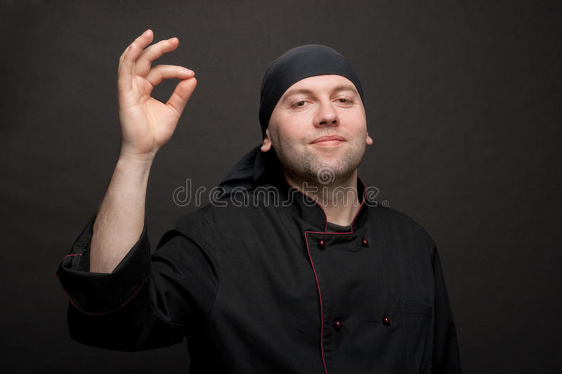 Chef in black uniforms royalty free stock image