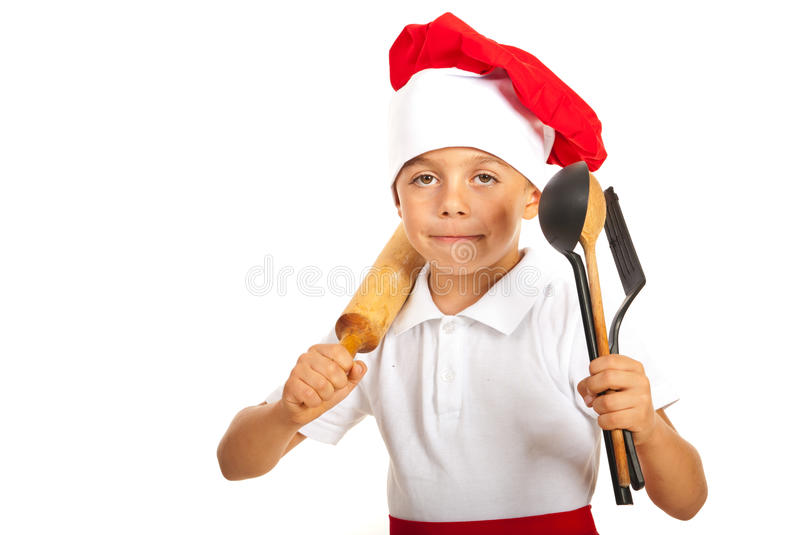 Chef boy with many utensils royalty free stock image
